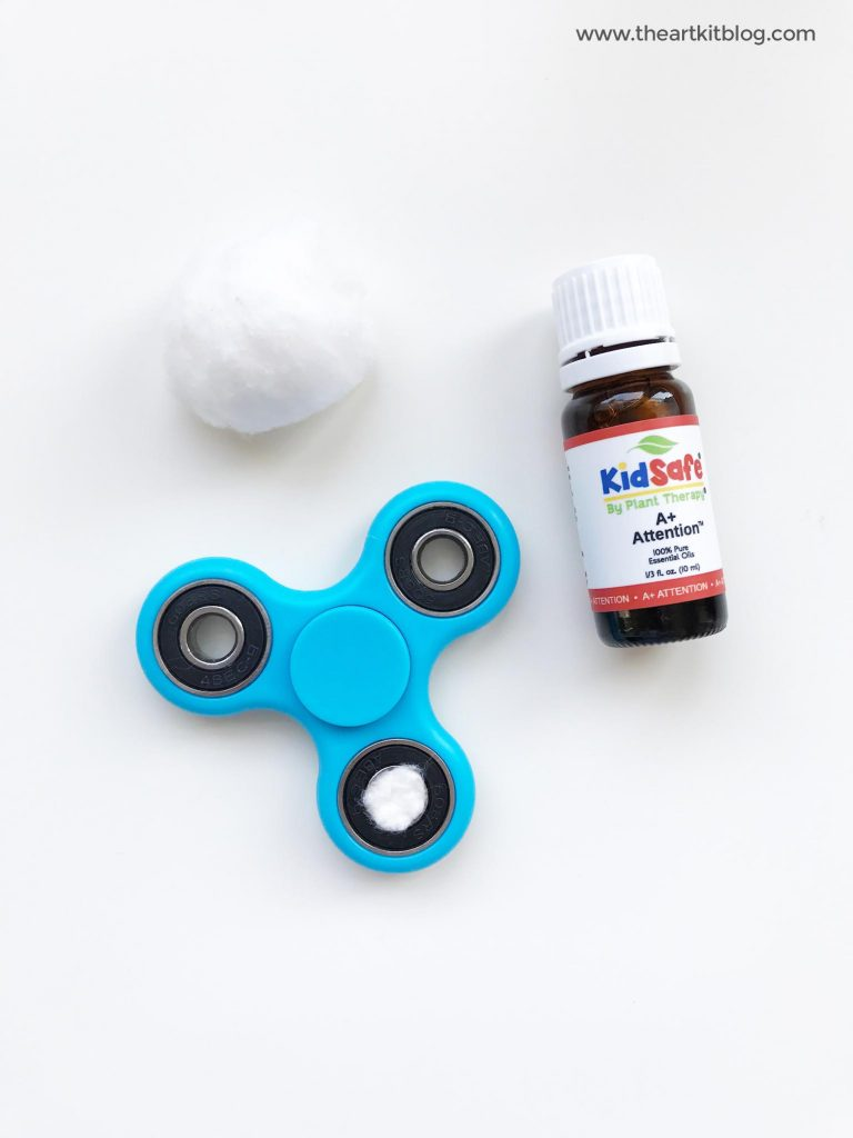 Fidget spinner and essential oils by the art kit