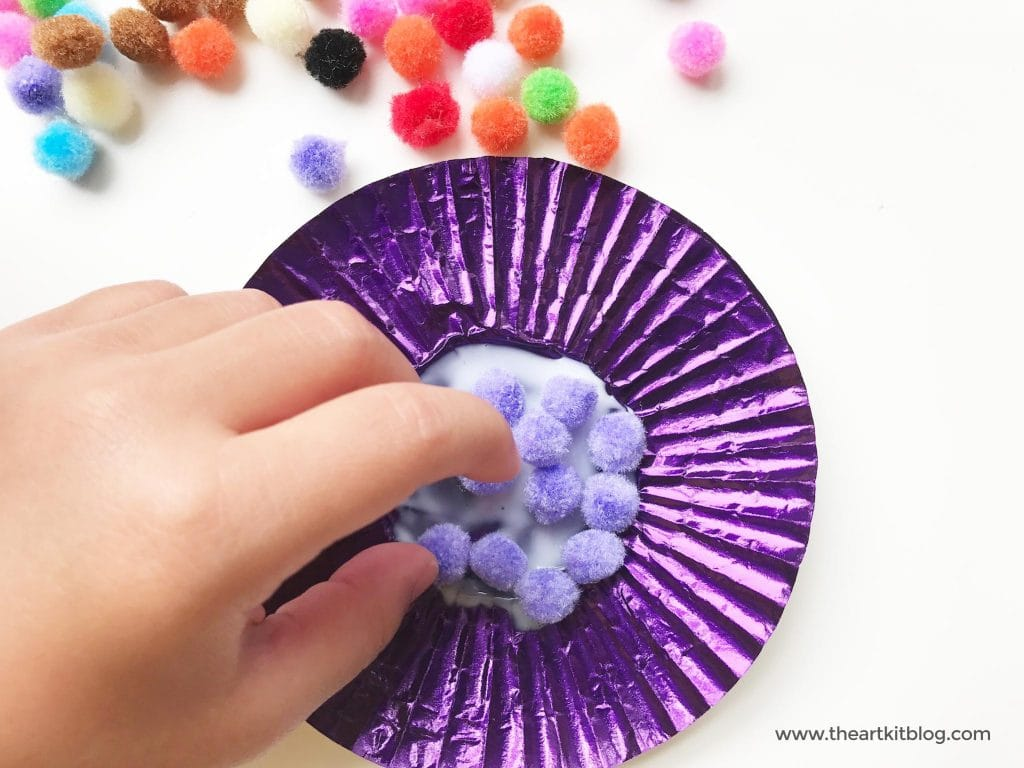 Cupcake liner flower craft easy craft for toddlers preschoolers from the art kit blog