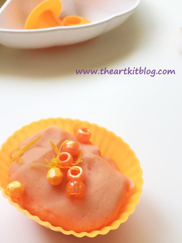 How to Make Orange Scented Playdough from The Art Kit Blog - Visit the blog today or pin for later