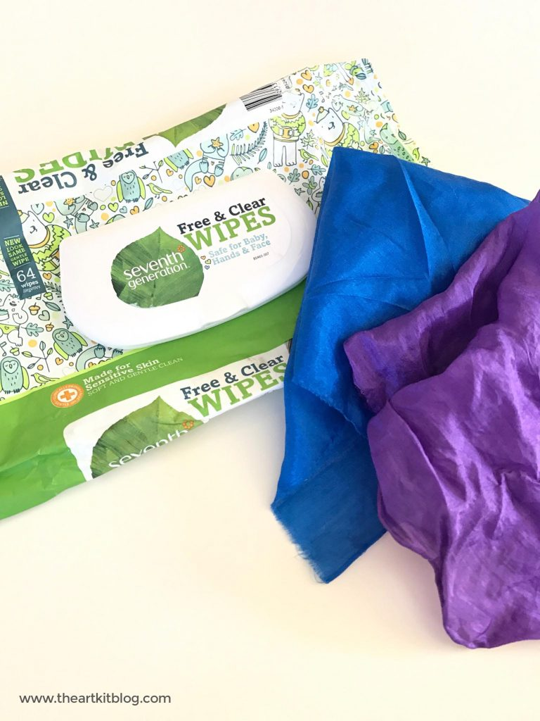 Try this easy baby diy using playsilks and an empty wipe package. See this and more ideas at @theartkit www.theartkitblog.com
