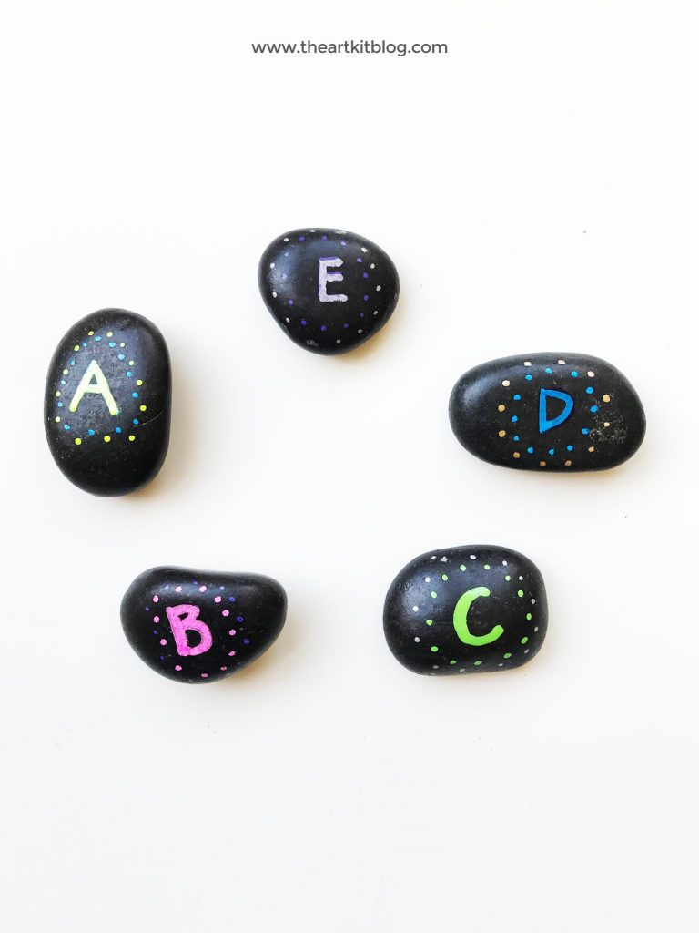Alphabet rocks - an easy DIY rock painting for literacy from @theartkit www.theartkitblog.com